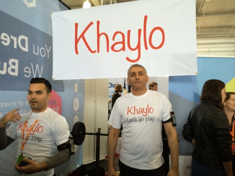 Arjun Rishi, the CEO and president of Khaylo in front of his booth